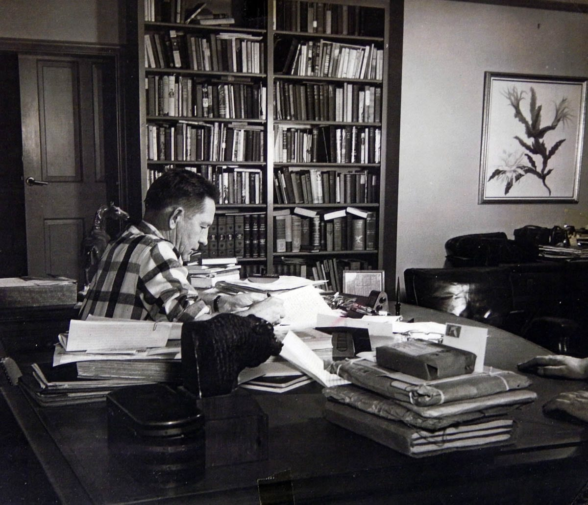 Bromfield writing at his desk