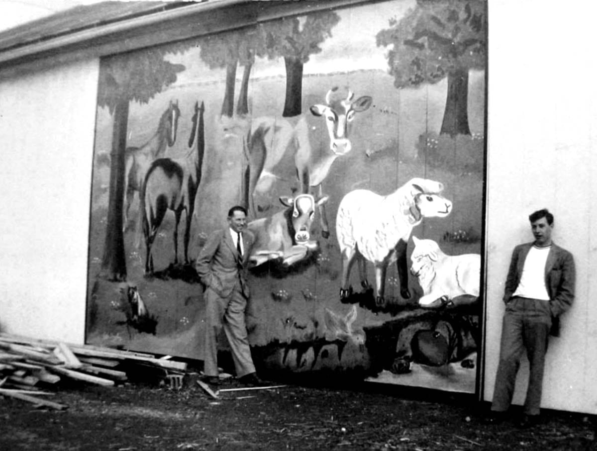 Photo of the main barn with mural painting of farm animals