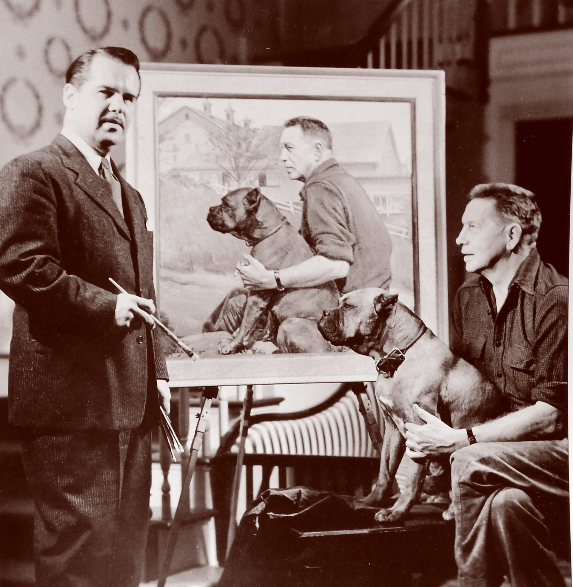 J. Anthony Wills posing with Bromfield and Bromfield portrait painting